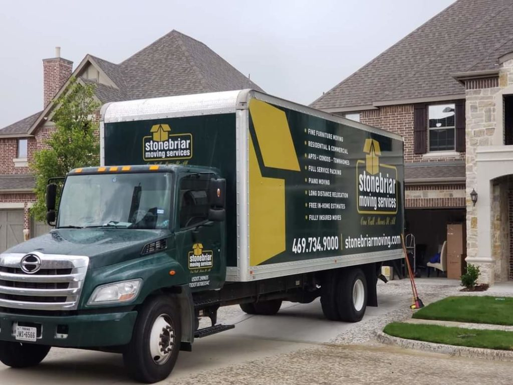 An image of the Stonebriar Moving company truck at a house.