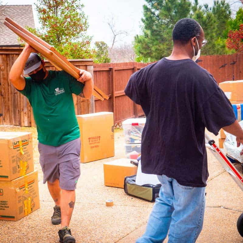 This image shows a professional moving crew moving items.