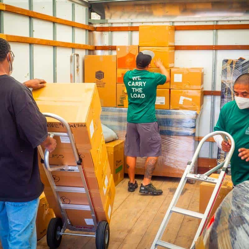 Image: Stonebriar Moving crew working together to load boxes.