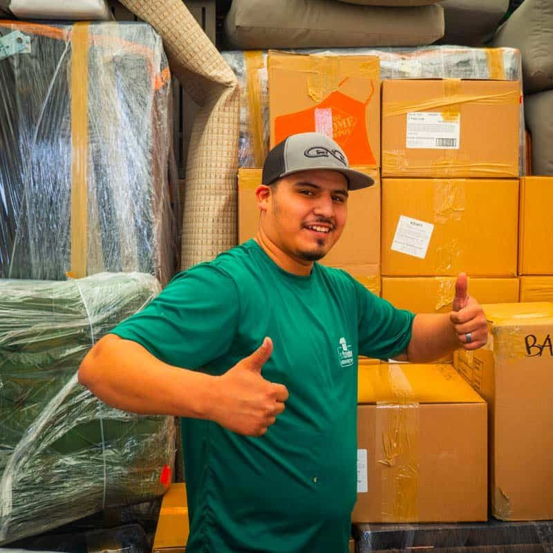 Image: a Stonebriar Moving crew member with his thumbs up.